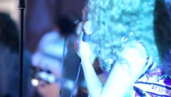 Singers which sing and dance while singing on stage in club, where many Stock Footage