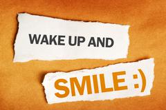 Wake up and smile motivational message Stock Photos