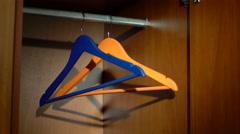 Swinging hangers in a wardrobe - stock footage