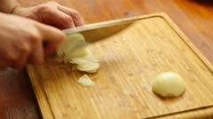 The hands cutting onions on a chopping board Stock Footage
