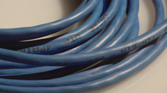 A blue rolled computer cable Stock Footage