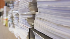 Piles of documents stored in the office Stock Footage