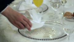 Waiter put a napkin on the plate on the table guest 39 - stock footage