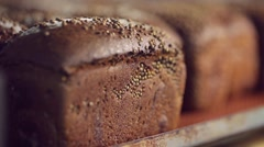Just baked bread loafs on the shelves in a bakery. Stock Footage