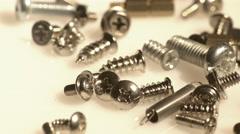 Pile of metal screws closeup Stock Footage