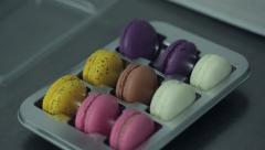 Cooking colorful crispy fresh macaroons - stock footage