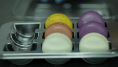 Making colorful Macaroons in a steel form Stock Footage