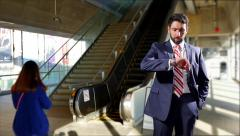 4K Impatient Businessman Checking Watch Waiting at Train Station Terminal Stairs - stock footage