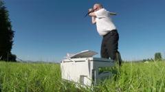 Printer repairman getting revenge with a baseball bat Stock Footage