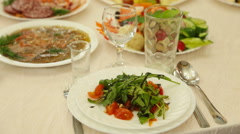 Catering table set service with silverware and glass Stock Footage