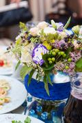 bouquet of flowers at the wedding table served - stock photo