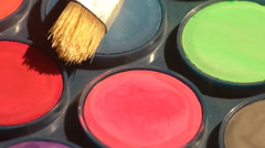 Watercolor paints and a brush Stock Footage