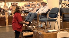 Woman shining boots at the Houston Livestock and rodeo show. Stock Footage