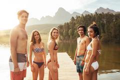 Teenager in swimwear standing at the lake - stock photo