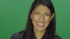 Ethnic woman smiling and laughing, on a green screen background Stock Footage