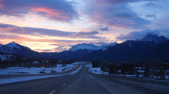Sunrise in the Rocky Mountains. TransCanada highway in Canmore, Alberta. - stock footage