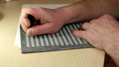 Hands squeeze blind Braille characters unseeing writes a letter Stock Footage