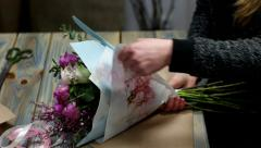 Bouquet of flowers with pink roses for delivery to his girlfriend of the guy Stock Footage
