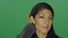 Ethnic woman fixing her hair, on a green screen background Stock Footage