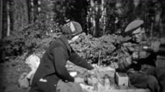1933: Couple having outdoor picnic pouring hot coffee from canteen. Stock Footage
