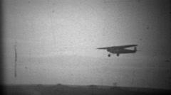 1934: Propeller plane landing in primitive airport landing strip. Stock Footage