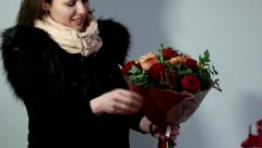 Girl sees a beautiful colored bouquet of flowers in her hands Stock Footage