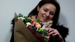 Happy girl looks out given to her on the day of St. Valentine bouquet Stock Footage