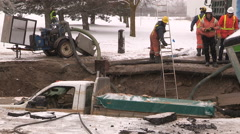 Spectacular sinkhole swallows truck and trailer in Kitchener Canada Stock Footage