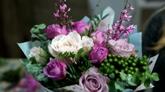Pink and white roses in a beautiful bouquet of gentle turns to display - stock footage