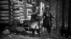 1934: Couple leaving rural log cabin for vacation fishing spot. Stock Footage