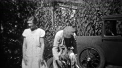 1934: Man wearing necklace of hunted dead geese around neck. Stock Footage