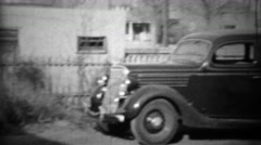 1934: New Plymouth car parked in suburban residential driveway. Stock Footage
