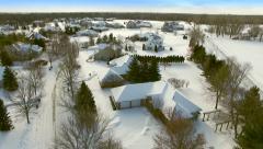 Winter flyover of wealthy suburban neighborhood homes. Stock Footage