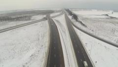 Aerial shot of highway with cars in winter Stock Footage