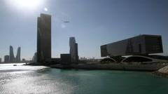 Manama City Skyline and Bahrain Bay  - A bird flying in the sky. Stock Footage