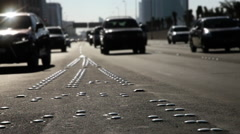 Traffic on a highway. Backlighting - Tilt Shift Lens - stock footage