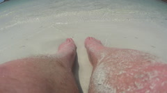 Man Resting Feet In Sand At Beach Stock Footage
