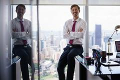 Portrait Of White Collar Worker Smiling At Camera In Office Stock Photos