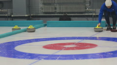 The player rolls a curling stone - stock footage