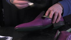 Handmade coloring and care of footwear Stock Footage