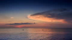 View of Boat Silhouettes at Sunset Dark Sky Pink Cloud Stock Footage