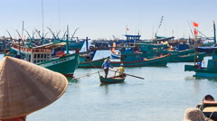 Vietnamese Woman in Hat Passes by against Boats in Bay - stock footage
