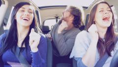 Three happy cool friends driving car singing and dancing happy 4K Stock Footage
