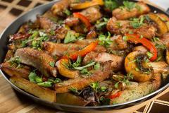 roast meat in a frying pan - stock photo