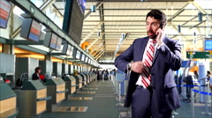 4K Businessman on Travel, Airport Check In Counter, Mobile Cell Phone Stock Footage