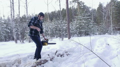 Lumberjack chainsaw manual sawing wood in the winter snowy forest Stock Footage