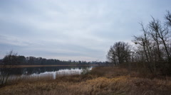 4k Timelapse of cloudy sky over lake at autumn. Stock Footage