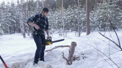 Lumberjack tries to start manual chainsaw Stock Footage