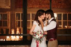 Wedding Couple Kissing in Loft Interior - stock photo