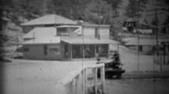1934: Man riding railroad tracks on fast motorized velocipede handcar. Stock Footage